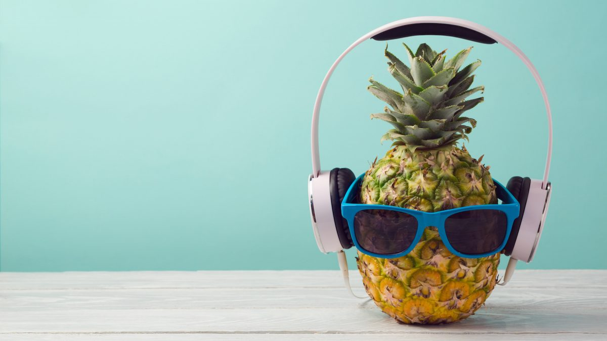 Pineapple with headphones and sunglasses